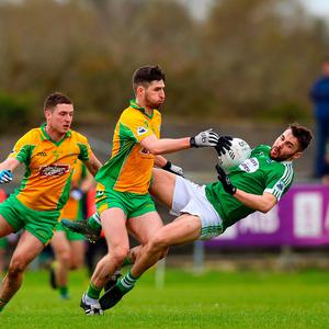Pressure on: Corofin's Martin Farragher battles with Micheal O'Cearbhaill of Gaoth Dobhair