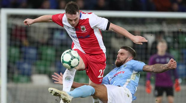 Linfield's Jamie Mulgrew is tackled by Ballymena's Steven McCullough. Photo by David Maginnis/Pacemaker Press