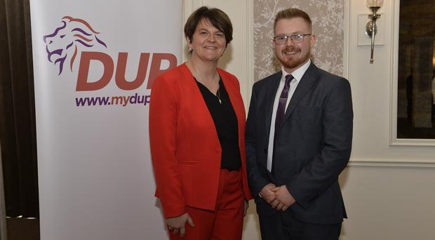 Kyle Black alongside DUP leader Arlene Foster