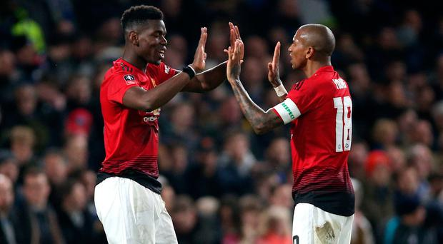 Manchester United's Paul Pogba (left) celebrates with Ashley Young