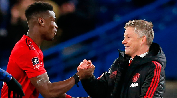 All smiles: Paul Pogba and Ole Gunnar Solskjaer celebrate