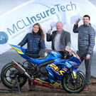 Revved up: Laura Scott and Rick Bell from MCL InsureTech are welcomed on board by NW200 event director Mervyn Whyte