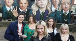Derry Girls creator Lisa McGee, second from left, with cast members Dylan Llewellyn , Saoirse-Monica Jackson, Louisa Harland and Nicola Coughlan when they visited the 'Derry Girls' mural painted by UV Artists on the gable wall of Badger's Bar, Derry. The second series of the hit show is coming soon to Channel 4. Pic Lorcan Doherty Presseye