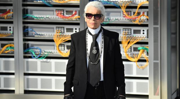 PARIS, FRANCE - OCTOBER 04: Designer Karl Lagerfeld walks the runway during the Chanel show as part of the Paris Fashion Week Womenswear Spring/Summer 2017 on October 4, 2016 in Paris, France. (Photo by Pascal Le Segretain/Getty Images)
