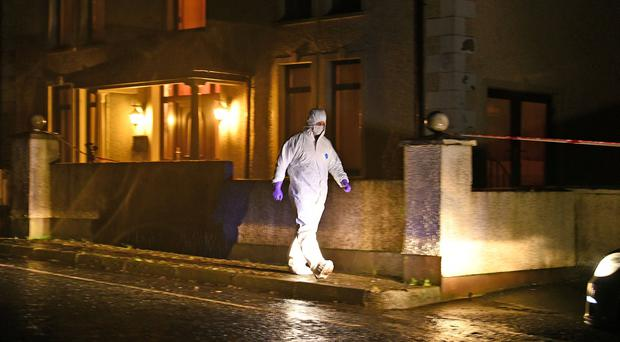 A PSNI Major Investigation Team, (MIT), are tonight investigating the discovery of a man's body at a property on the Church Road at Glenwherry in County Antrim. Picture: Alan Lewis