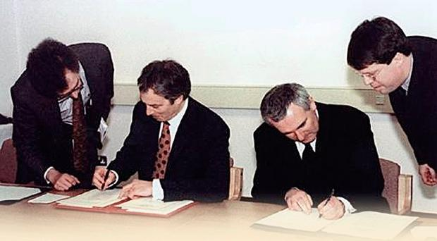 Prime Minister Tony Blair and Taoiseach Bertie Ahern sign the Good Friday Agreement