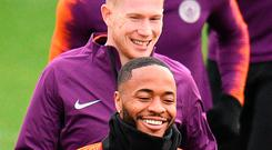 Striding on: Kevin de Bruyne and Raheem Sterling in training