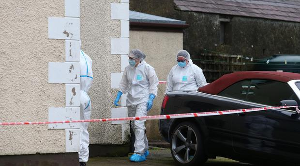 The forensics team outside the home of David Murphy. Credit: Pacemaker.