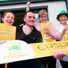 Les Reilly (second left) and the staff of Reilly's Daybreak in Naul, Co Dublin, celebrate selling the EuroMillions €175 million winning lotto ticket