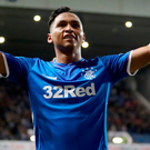 On fire: Alfredo Morelos completes his hat-trick for Rangers last night on the way to a four-goal haul