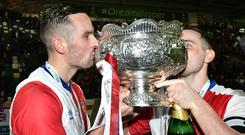 Glory boys: Andy Waterworth (left) and Jamie Mulgrew celebrate with the League Cup last weekend