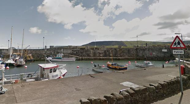 The officer's car was rammed in the Carnlough Harbour area. Pic Google Maps