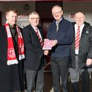 Robson Davison, author of 'The Comrades', presents Chairman Trevor McCann with the first copy of the special Centenary Book. Pictured left to right: Seamus Reid (Reid Black Solicitors), Trevor McCann Chairman, Robson Davison Author, Robert Fleck Treasure and Justyn Wallace Committee.