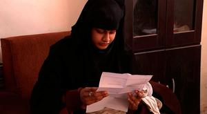 Shamima Begum being shown a copy of the Home Office letter stripping her of her British citizenship