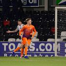 Magic man: Glenavon ace Josh Daniels celebrates after conjuring up a piece of magic to beat Sean O'Neill