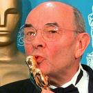 Stanley Donen kisses the Oscar he received for Lifetime Achievement (Reed Saxon/AP)