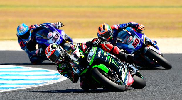 Front runner: Jonathan Rea leads race three in yesterday's World Superbikes opener in Australia but finished in second place