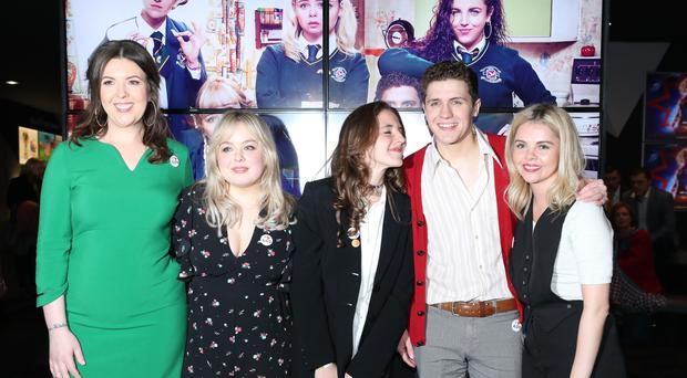 Writer Lisa McGee with the Derry Girls cast members (Niall Carson/PA)