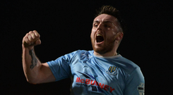 On high: Cathair Friel hails his opener for Ballymena United