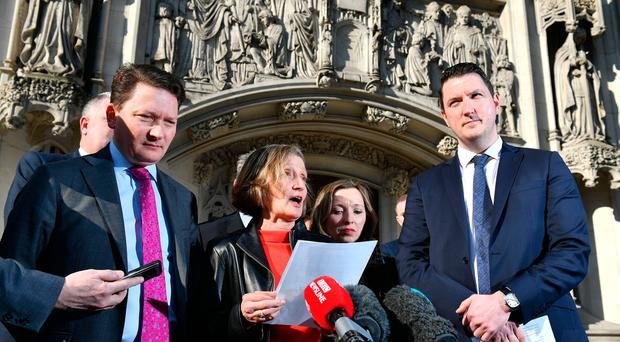 Geraldine Finucane, the widow of murdered Belfast solicitor Pat Finucane, accompanied by her sons John (right) and Michael (left) speaks with reporters outside the Supreme Court in central London