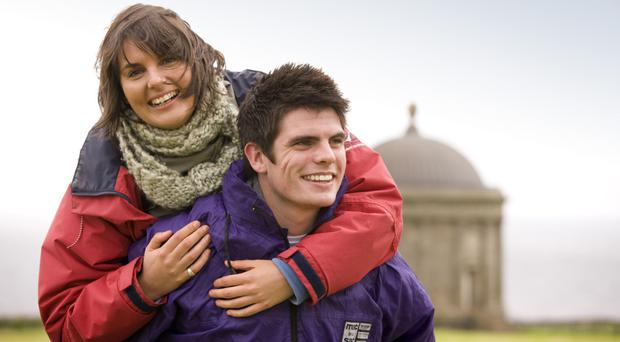 Young couple enjoying a day out at Mussenden Temple at the Downhill Demesne, County Londonderry, Northern Ireland.