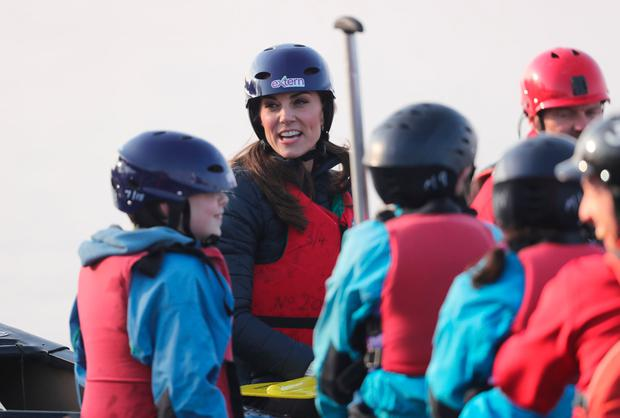 The Duchess of Cambridge takes part in a canoe lesson during her and the Duke of Cambridge's visit to Roscor Youth Village, Co Fermanagh. Photo credit: Niall Carson/PA Wire