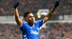 Three and easy: Alfredo Morelos celebrates scoring Rangers' third goal in last night's comfortable victory at Ibrox