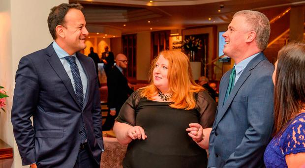 Taoiseach Leo Varadkar at the Alliance Party conference last night with party leader Naomi Long and Michael Long, Alliance councillor for Belfast PA
