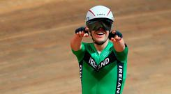 All smiles: Mark Downey celebrates his bronze medal in the men's points race at the World Track Championships in Poland