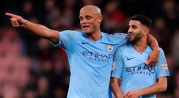 City goal-scorer Riyad Mahrez (right) celebrates with Vincent Kompany.
