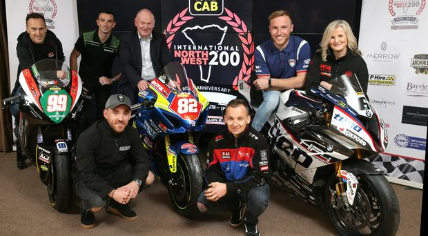 Mervyn Whyte, Event Director, pictured with racers Jeremy McWilliams, Glenn Irwin, Lee Johnston, Richard Cooper, Davey Todd and Maria Costello. Credit: Stephen Davison