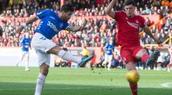 Rangers' Daniel Candeias (left) shots over during the William Hill Scottish Cup quarter final match at Pittodrie Stadium, Aberdeen.