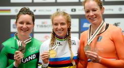 (L-R) Silver medalist Ireland's Lydia Boylan, winner Australia's Alexandra Manly and third placed Kirsten Wild of The Netherlands' celebrate during the award ceremony for the Women's Point Race at the UCI Track Cycling World Championships in Pruszkow