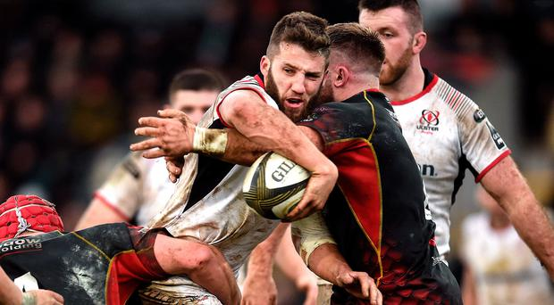 Hands on: Stuart McCloskey offloads despite the tackle of Rhys Lawrence