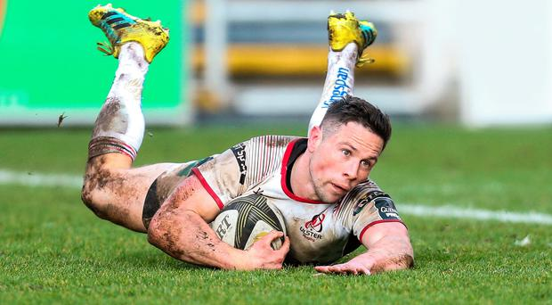 Touchdown: Ulster's John on a day Cooney crosses the line for his try in Newport