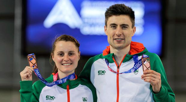 Double delight: Ireland's Ciara Mageean and Mark English with their bronze medals at the European Athletics Indoor Championships last night