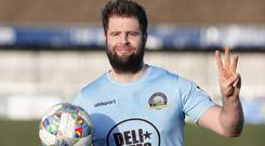 Warrenpoint Town Simon Kelly celebrates his hat-trick in Saturday's Irish Cup quarter-final.