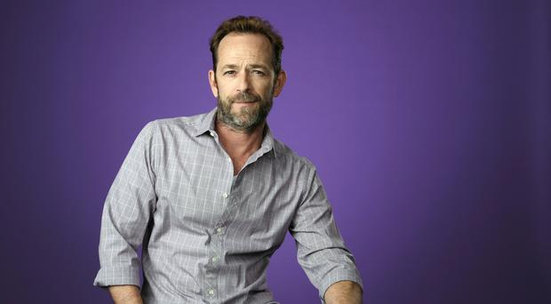 Shannen Doherty has paid an emotional tribute to Luke Perry (Chris Pizzello/Invision/AP, File)
