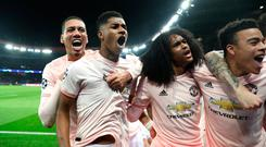 Marcus Rashford celebrates his late goal with Chris Smalling and Tahith Chong.