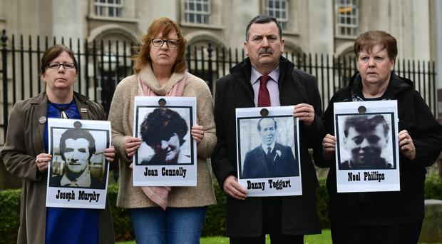 Families of people killed at Ballymurphy outside Laganside Court yesterday