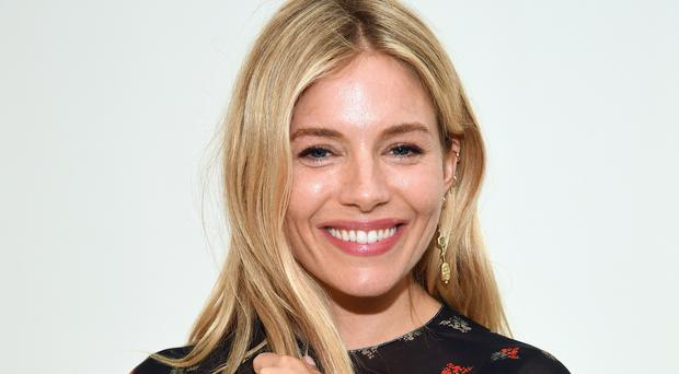 Sienna Miller (Photo by Dimitrios Kambouris/Getty Images for International Medical Corps)