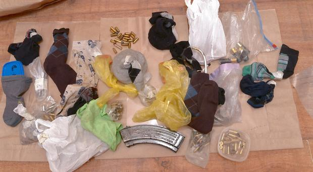 The assortment of ammunition and bomb-making components found during searches of a house in west Belfast