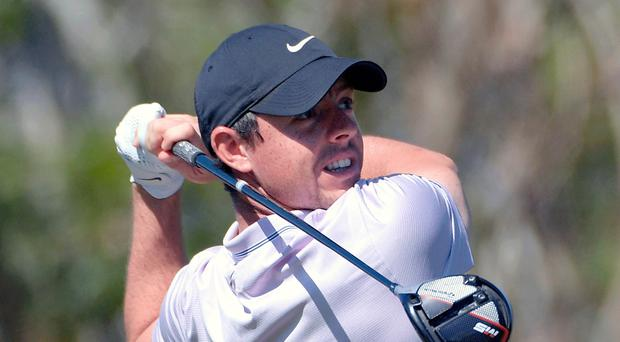Eyes on prize: Rory McIlroy in yesterday's second round