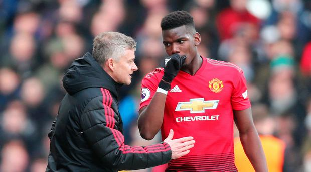 Tactician: Ole Gunnar Solskjaer gives instructions to Paul Pogba