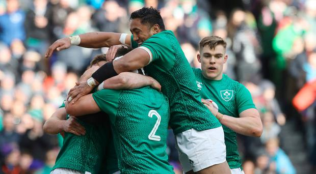 Ireland's Jonny Sexton (obscured) celebrates with team-mates after scoring a try during the Guinness Six Nations match at the Aviva Stadium, Dublin. Photo credit: Lorraine O'Sullivan/PA Wire.