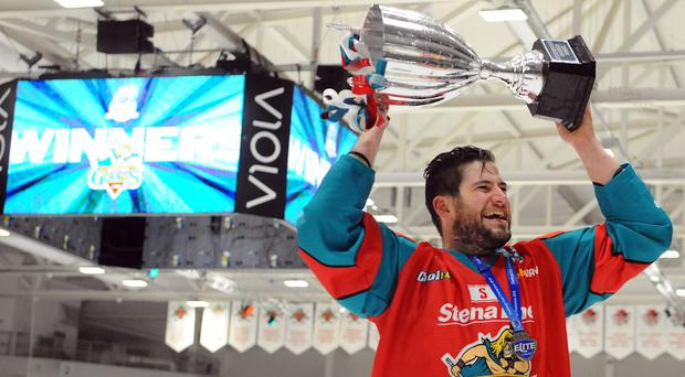 Belfast Giants forward Jordan Smotherman with the Challenge Cup trophy