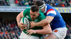 Power play: Jack Conan of Ireland is tackled by Guilhem Guirado of France but the Frenchman can't stop him scoring a try
