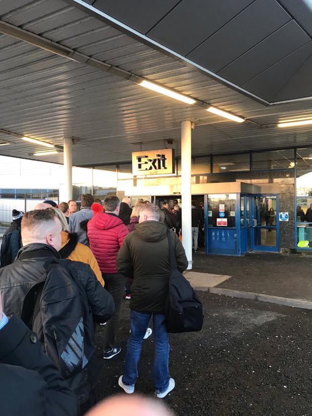 Queues out the door at Belfast International Airport.