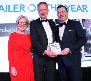 Glyn Roberts with last year's Retailer of the Year Keith Irvine of Warden Bros and Wendy Austin
