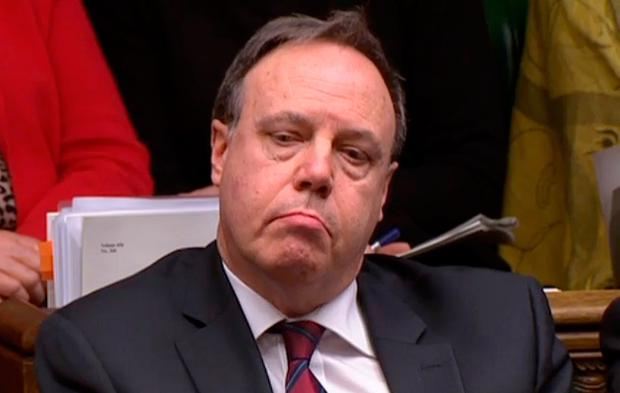 Nigel Dodds listens to the Attorney General in the Commons.